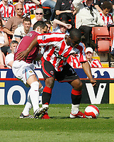 Photo: Paul Greenwood.<br />Sheffield United v West Ham United. The Barclays Premiership. 14/04/2007.<br />West Ham's Matthew Etherington (L) looses out to Christian Nade