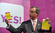 licensed to London News Pictures. LONDON UK. 27/04/11. Nigel Farage holds up campaign leaflets for UKIP and the NO campaign. A News conference held today (27 April 2011) in Church House, London. The conference was introduced by Katie Ghose with Lib Dem President Tim Farron, Green Party Leader Caroline Lucas, UKIP leader Nigel Farage and  Labour's  Alan Johnson, supporting a Yes for the Alternative Vote. Photo credit should read Stephen Simpson/LNP