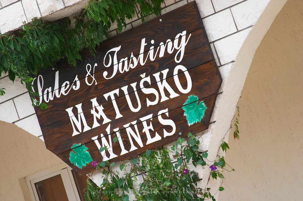 Entrance to the winery with sign Sales and Tasting. Matusko Winery. Potmje village, Dingac wine region, Peljesac peninsula. Matusko Winery. Dingac village and region. Peljesac peninsula. Dalmatian Coast, Croatia, Europe.