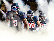 Oct. 22, 2011 - Charlottesville, Virginia - USA; Virginia Cavaliers players run onto the field during an NCAA football game against the North Carolina State Wolfpack at the Scott Stadium. NC State defeated Virginia 28-14. (Credit Image: © Andrew Shurtleff