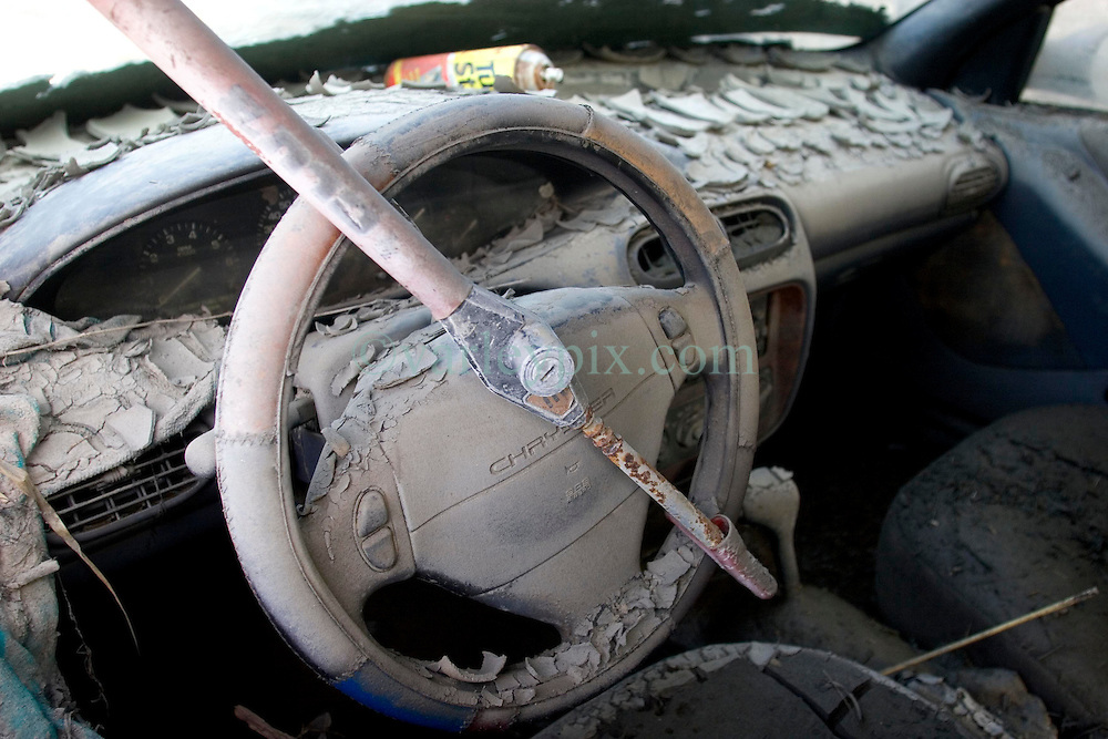 30 Sept, 2005.  New Orleans, Louisiana. Lower 9th ward. Hurricane Katrina aftermath. <br /> The remnants of the lives of ordinary folks, now covered in mud as the flood waters remain. The dashboard of a Chrysler, covered in dried mud.<br /> Photo; ©Charlie Varley/varleypix.com