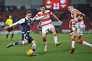 Jed Wallace of Millwall FC crosses the ball against Aaron Taylor-Sinclair of Doncaster Rovers  and Harry Middleton of Doncaster Rovers  during the Sky Bet League 1 match between Doncaster Rovers and Millwall at the Keepmoat Stadium, Doncaster, England on 27 February 2016. Photo by Ian Lyall.