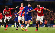 Alvora Morata of Chelsea © is chased down by Antonio Valencia ® and Eric Bailey of Manchester United .Premier league match, Chelsea v Manchester United at Stamford Bridge in London on Sunday 5th November 2017.<br /> pic by Andrew Orchard sports photography.