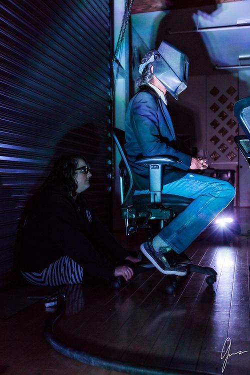 Cure for Gravity<br /> Music Video Production Stills<br /> Oil scene<br /> <br /> Director: Daniel Garcia<br /> Art Director: Treigh Love<br /> Photo Art Director and Production Stills: Geneva Bumb Shanti<br /> Actors: Joe Market, Darren Thompson and
