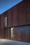 Steel exterior with windows of Hackney Marshes sports centre in East London at dusk