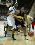 Christina Lasane (4) of Arkansas-Pine Bluff drives the ball past A'Shanti Weathers (21) of Mississippi Valley State University during the SWAC semi-finals at the Curtis Culwell Center in Garland on Friday, March 15, 2013. (Cooper Neill/The Dallas Morning News)