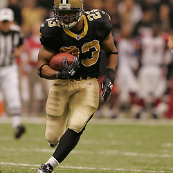 16 January 2010:  New Orleans Saints running back Pierre Thomas (23) runs with the ball against the Arizona Cardinals during a 45-14 win by the New Orleans Saints over the Arizona Cardinals in a 2010 NFC Divisional Playoff game at the Louisiana Superdome in New Orleans, Louisiana.