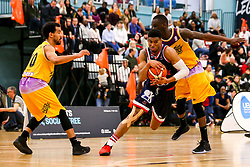 Justin Gray of Bristol Flyers goes past Ladarius Tabb of London Lions - Photo mandatory by-line: Robbie Stephenson/JMP - 10/04/2019 - BASKETBALL - UEL Sports Dock - London, England - London Lions v Bristol Flyers - British Basketball League Championship