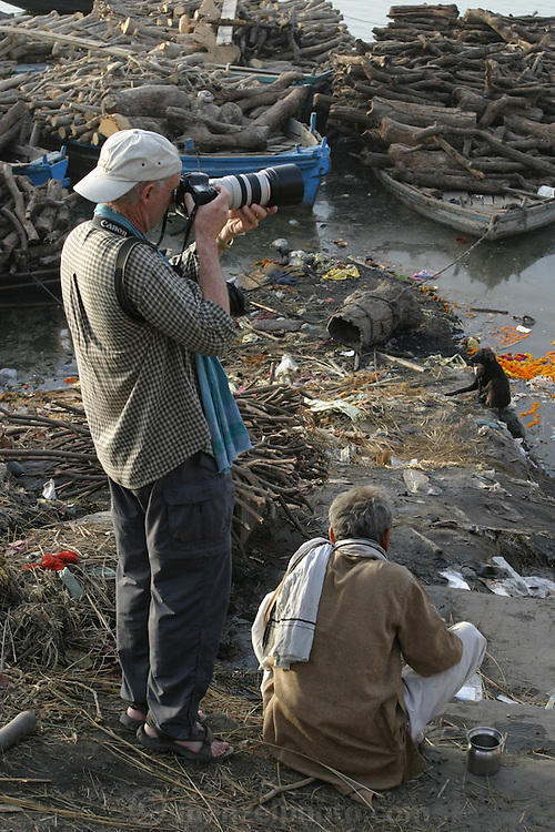 Peter Menzel photographing at Manikarnika Ghat on the Ganges River in Varanasi India. The Bodies arrive day and night from far and near to be cremated at Jalasi Ghat, the cremation grounds at Manikarnika Ghat.