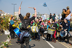 London, UK. 15th April 2019. Climate campaigners from Extinction Rebellion begin 'International Rebellion UK - Shut Down London!' events by blocking Waterloo Bridge to start creating a Garden Site along the length of the bridge to call on the Government to take urgent action to address climate change.