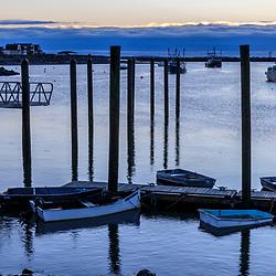 Clouds hug the horizon at dawn in Rye Harbor, New Hampshire.