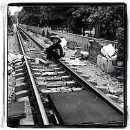 A vietnamese woman sits on the railway of Hanoi, Vietnam, Southeast Asia