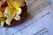 Correspondence from Hotel management to guests, with small tray of Frangipani flowers. Sanur, Bali, Indonesia.