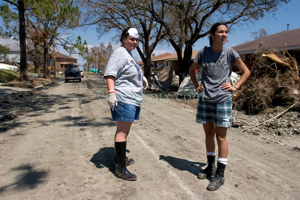 08 Sept 2005.  New Orleans, Louisiana. Hurricane Katrina aftermath. <br /> Venetian Isles in East New Orleans, where the tidal surge washed over the land and devastated homes and property.<br /> L/R; Lindsay Lala and her neighbour Yvette Trahan survey the damage to their mud filled flood ravaged homes.<br /> Photo; ©Charlie Varley/varleypix.com