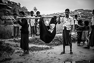 A woman is carried in a sling at Chakmarkul refugee camp, Bangladesh (October 28, 2017)
