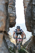 Jampie Vlok cuts between two sandstone stacks during Stage 3 of the Momentum Health Tankwa Trek, presented by Biogen, on Sunday 12 February 2017.