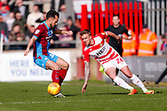Doncaster Rovers midfielder James Coppinger (26) in action  during the EFL Sky Bet League 1 match between Scunthorpe United and Doncaster Rovers at Glanford Park, Scunthorpe, England on 23 February 2019.