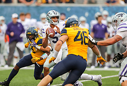 Sep 22, 2018; Morgantown, WV, USA; Kansas State Wildcats quarterback Alex Delton (5) throws a pass during the fourth quarter against the West Virginia Mountaineers at Mountaineer Field at Milan Puskar Stadium. Mandatory Credit: Ben Queen-USA TODAY Sports