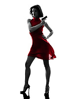 one sexy  woman holding gun in silhouette studio isolated on white background