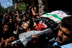 May 4, 2019 - Beit Hanoun, Gaza Strip - Imad Mohammed Nasir, 22, receives his final farewell during his funeral in the northern Gaza Strip after being killed in an Israeli airstrike in the northern Gaza Strip.  On Saturday Israeli airstrikes hit at least three separate areas of the  Gaza Strip and were responsible for killing Imad and wounding three other Palestinians. The air strikes were in response to the firing of dozens of rockets from Gaza into Israel early Saturday, which followed an Israeli attack on a Hamas site the previous day that had resulted in the death of two Palestinians (Credit Image: © Ahmad Hasaballah/IMAGESLIVE via ZUMA Wire)