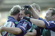 Reading, Berkshire, UK., 26th October 2003, Zurich Premiership Rugby, Madejski Stadium, England, [Mandatory Credit: Peter Spurrier/Intersport Images],<br />  <br /> <br /> 2003_04 Zurich Premiership Rugby - London Irish v Rotherham<br /> Exiles Barry Everitt (with ball), surrounded by team mates celebrates a second half try.