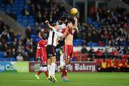 Cardiff's Sean Morrison (r) is challenged and has his shirt pulled  by Rotherham's Craig Morgan © and Scott Wooton (l) . Skybet football league championship match, Cardiff city v Rotherham Utd at the Cardiff city stadium in Cardiff, South Wales on Saturday 6th December 2014<br /> pic by Andrew Orchard, Andrew Orchard sports photography.