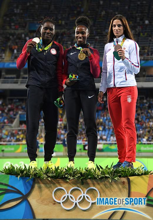 Aug 18, 2016; Rio de Janeiro, Brazil; Women's long jump gold medalist Tianna Bartoletta (USA), center, poses with silver medalist Brittney Reese (USA), left, and bronze medalist Ivana Spanovic (SRB) during the 2016 Rio Olympics at Estadio Olimpico Joao Havelange.