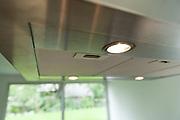 closeup of a modern inox cooker hood, light