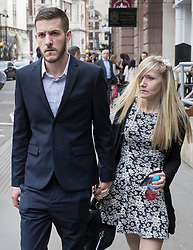 © Licensed to London News Pictures. 23/05/2017. London, UK. CONNIE YATES AND CHRIS GARD are seen outside The Royal Courts of Justice in London where they are appealing an earlier court ruling that doctors can withdraw life-support treatment to their son, Charlie, who suffers from a rare genetic condition.  Doctors at Great Ormond Street Hospital in London say eight-month-old Charlie should be left to die in dignity, but his parents have raised over £1 million for specialist treatment in America. Photo credit: Peter Macdiarmid/LNP