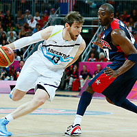 06 August 2012: Argentina Andres Nocioni drives past Kobe Bryant during 126-97 Team USA victory over Team Argentina, during the men's basketball preliminary, at the Basketball Arena, in London, Great Britain.