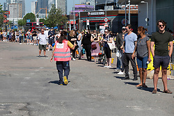 © Licensed to London News Pictures. 01/06/2020. London, UK. A social distancing warden speaks to people in a large queue outside the Greenwich branch of Ikea which reopened today. The store has been closed since lockdown began in March. Photo credit: George Cracknell Wright/LNP