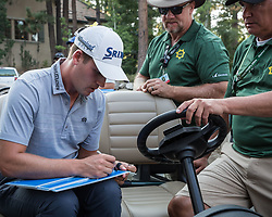August 5, 2018 - Reno, Nevada, U.S - Sunday, August 5, 2018.ANDREW PUTNAM, signs autographs immediately following his win at the 2018 Barracuda Championship at the Montreux Golf & Country Club in Reno, Nevada. The Montreux Golf & Country Club is located midway between Reno and Lake Tahoe...The Barracuda Championship Golf Tournament is one of only 47 stops on the PGA Tour worldwide, and has donated nearly $4 million to charity since 1999. Opened in 1997, the par-72 course was designed by Jack Nicklaus, plays at 7,472 yards (6,832 m) and its average elevation is 5,600 feet (1,710 m) above sea level...As the tournament champion, Putnam, received a check in the amount of $612,000. (Credit Image: © Tracy Barbutes via ZUMA Wire)