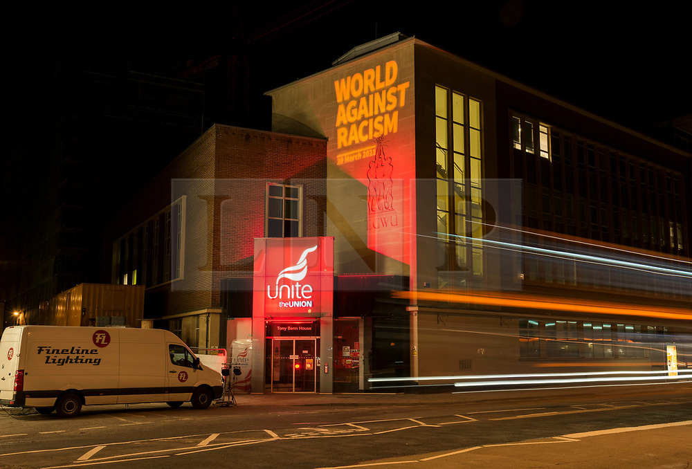 """© Licensed to London News Pictures; 20/03/2021; Bristol, UK. The words """"World Against Racism"""" are projected onto the side of Tony Benn House, the south west regional offices of Unite the Union, for the World Against Racism online rally on UN Anti-Racism Day on 20 March. The 21 March is the International Day for the Elimination of Racial Discrimination. Photo credit: Simon Chapman/LNP."""