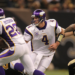 Jan 24, 2010; New Orleans, LA, USA; Minnesota Vikings quarterback Brett Favre (4) hands off to running back Adrian Peterson (28) during a 31-28 overtime victory by the New Orleans Saints over the Minnesota Vikings in the 2010 NFC Championship game at the Louisiana Superdome. Mandatory Credit: Derick E. Hingle-US PRESSWIRE