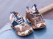 Muddy sneakers, Kaua'i, Hawai'i