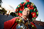 Djemaa el fna marrakech, man in traditional dress. Water carrier with the koutoubia mosque in the background Morocco travel photography