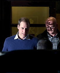 © London News Pictures. 04/12/2012. London, UK. A smiling Prince William (left) leaving King Edward VII Hospital  in London after visiting The Duchess Of Cambridge, Kate Middleton who is currently being treated for a type of severe morning sickness called hyperemesis gravidarum. The royal couple announced the pregnancy yesterday (Mon). Photo credit: Ben Cawthra/LNP