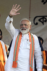 April 29, 2019 - Kolkata, West Bengal, India - Prime Minister Narendra Modi greets Bharatiya Janta Party or BJP supporters during an election campaign for Lok Sabha Election at Barrackpore constituency of North 24 Parganas. (Credit Image: © Saikat Paul/Pacific Press via ZUMA Wire)