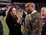 CHARLOTTESVILLE, VA- NOVEMBER 12: ACC ALL ACCESS host Jenn Hildreth, left, interview head coach Mike London of the Virginia Cavaliers after the game against the Duke Blue Devils on November 12, 2011 at Scott Stadium in Charlottesville, Virginia. Virginia defeated Duke 31-21. (Photo by Andrew Shurtleff/Getty Images) *** Local Caption *** Jenn Hildreth;Mike London
