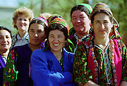 Local women wearing traditional outfits  in town of Mary in Turkmenistan