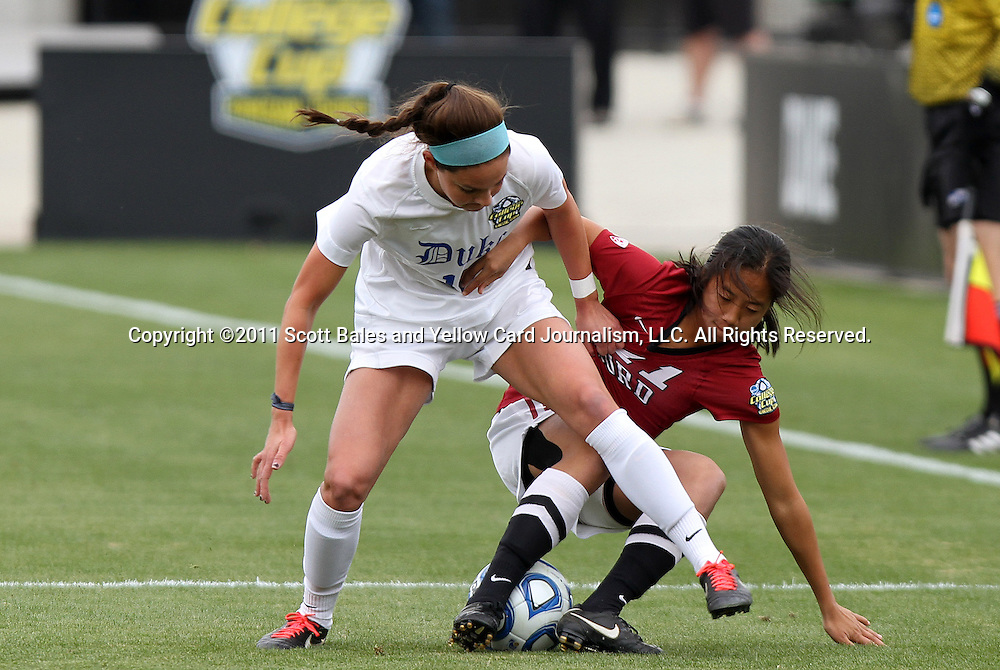 04 December 2011: Duke's Laura Weinberg (left) and Stanford's Rachel Quon (right) challenge for the ball. The Stanford University Cardinal defeated the Duke University Blue Devils 1-0 at KSU Soccer Stadium in Kennesaw, Georgia in the NCAA Division I Women's Soccer College Cup Final.