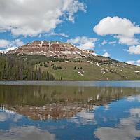 Beartooth Butte reflects in Beartooth Lake in the Absaroka Range of Wyoming, near Yellowstone.