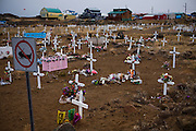 """A cemetery  in Iqaluit, Nunavut Territory, Canada. With a population of 6,000, Iqaluit is the largest community in Nunavut as well as the capital city, and is located in the southeast part of Baffin Island. Formerly known as Frobisher Bay, it is at the mouth of the bay of that name, overlooking Koojesse Inlet. """"Iqaluit"""" means 'place of many fish'."""