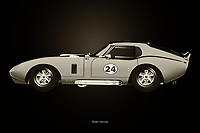 """The Shelby Daytona can be seen as a purely American answer to the many European sports cars; The powerful and very large engine makes this Shelby Daytona so typical and it has no equal. Many boys and girls dream to be able to conquer this Shelby Daytona, as is shown in the movie the """"Buckt List"""" in which the Shelby Daytona is performed.<br /> <br /> This painting of a Shelby Daytona can be printed very large on different materials. –<br /> <br /> BUY THIS PRINT AT<br /> <br /> FINE ART AMERICA<br /> ENGLISH<br /> https://janke.pixels.com/featured/shelby-daytona-black-and-white-jan-keteleer.html<br /> <br /> WADM / OH MY PRINTS<br /> DUTCH / FRENCH / GERMAN<br /> https://www.werkaandemuur.nl/nl/shopwerk/Shelby-Daytona-Zwart-en-Wit/743800/132?mediumId=11&size=75x50<br /> <br /> -"""