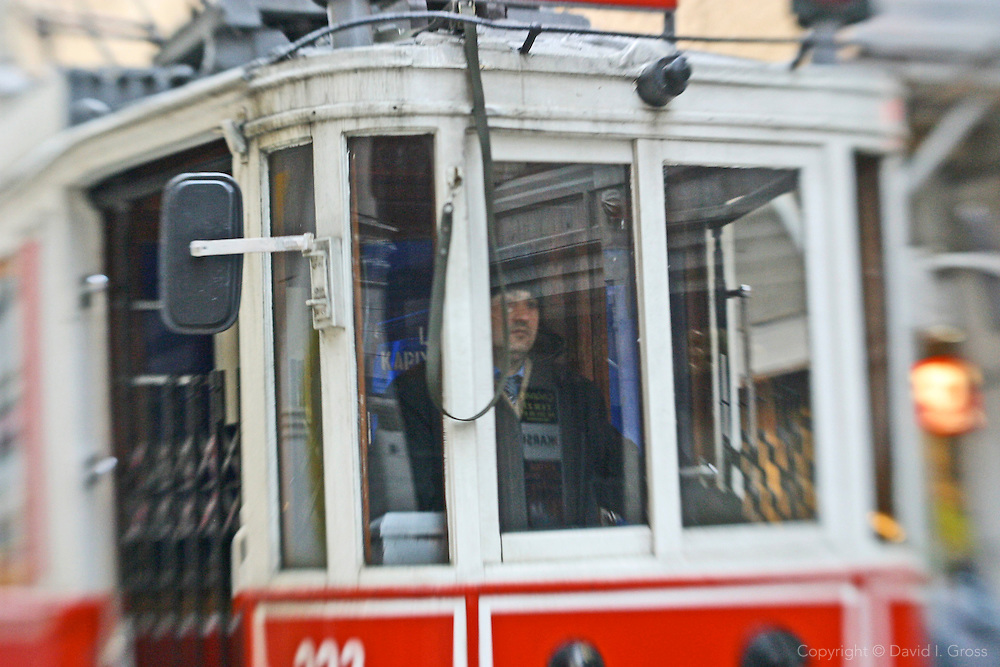 Old fashioned trams are the best way to get through the crowds on the main street in the Beyoglu district of Istanbul, Turkey..(Shot with a LensBaby distorting lens -- not retouched)