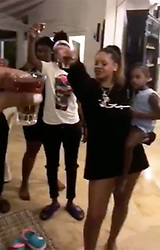 EXCLUSIVE: ** NO WEB UNTIL 11pm PST DECEMBER 29TH 2017** Rihanna raises a glass to her murdered cousin Tavon Alleyne. The superstar joined a gathering of close family and friends in Barbados to pay their respects to the 21-year-old who died after being shot several times at close range. One of the guests is heard saying 'this one is for you bro' in a mobile phone video shot as the group drink a shot 'for Tavon.' The words 'Rest easy blood!!!' have been added to parts of the video. Rihanna, wearing a black t-shirt and no shoes, is seen holding her beloved niece Majesty. The star, who is the child's godmother, calls herself 'Aunty Oh Na Na' and regularly posts Instagrams and snapshots of the adorable tot. Diamonds singer Rihanna, 29, who saw her cousin on Christmas Day, called for an end to gun crime in an Instagram message. 'RIP cousin... can't believe it was just last night that I held you in my arms!' the heartbroken Wild Thoughts singer wrote to her 59million Instagram followers. 'Never thought that would be the last time I felt the warmth in your body!!! Love you always man!' Alleyne was shot near a house in which he was living with his girlfriend in the parish of St Michael. It is believed police are currently questioning a suspect. 27 Dec 2017 Pictured: Rihanna. Photo credit: MEGA TheMegaAgency.com +1 888 505 6342
