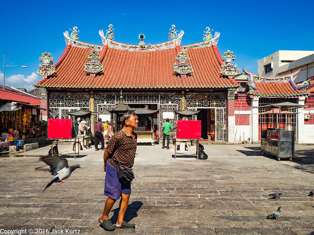 17 NOVEMBER 2016 - GEORGE TOWN, PENANG, MALAYSIA: A man walks past the Temple of the Goddess of Mercy in George Town, Penang. George Town is a UNESCO World Heritage city and wrestles with maintaining its traditional lifestyle and mass tourism.           PHOTO BY JACK KURTZ