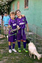 07 May 2016. New Orleans, Louisiana.<br /> NPSL Soccer, Pan American Stadium.<br /> Ben and Conor at the petting zoo before kick off for the New Orleans Jesters v Houston Hurricanes game. Jesters win 3-0. <br /> Photo; Charlie Varley/varleypix.com