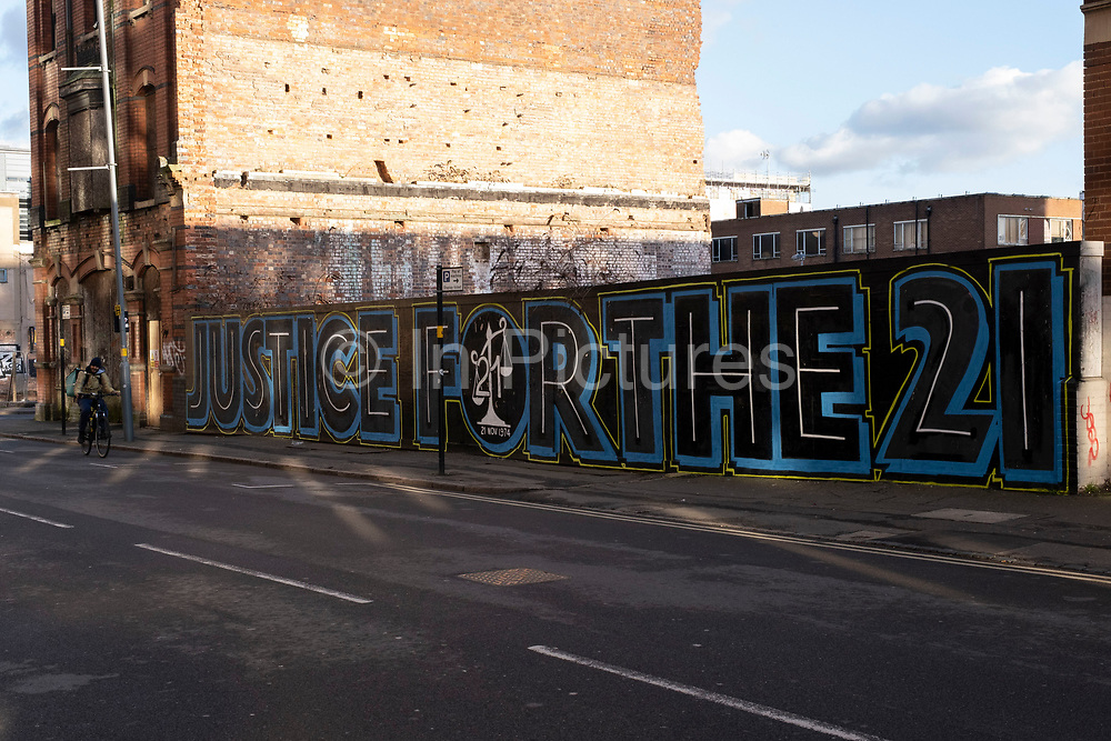 Justice for the 21 campaign street art graffiti mural for the victims of the Birmingham pub bombings on 26th November 2020 in Birmingham, United Kingdom. The Birmingham pub bombings were carried out on 21 November 1974, when bombs exploded in two public houses in Birmingham, England, killing 21 people and injuring 182 others.