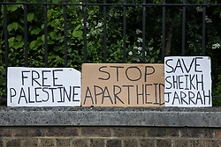Hand-made signs are pictured on a wall as tens of thousands of people attend a March for Palestine from Speaker's Corner to the Israeli embassy in solidarity with the Palestinian people on Nakba Day on 15th May 2021 in London, United Kingdom. The march, which was organised by Palestine Solidarity Campaign, CND, Friends of Al Aqsa, Muslim Association of Britain, Palestinian Forum in Britain and Stop The War Coalition, took place in protest against Israeli air raids on Gaza, the deployment of Israeli forces to the Al-Aqsa mosque during Ramadan and attempts to forcibly displace Palestinian families from the Sheikh Jarrah neighbourhood of East Jerusalem and speakers called for an end to Israeli support for and arms sales to Israel.